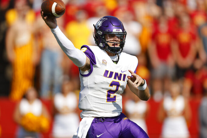 Northern Iowa quarterback Will McElvain (2) passes downfield against Iowa State during the first half of an NCAA college football game, Saturday, Sept. 4, 2021, in Ames, Iowa. (AP Photo/Matthew Putney)