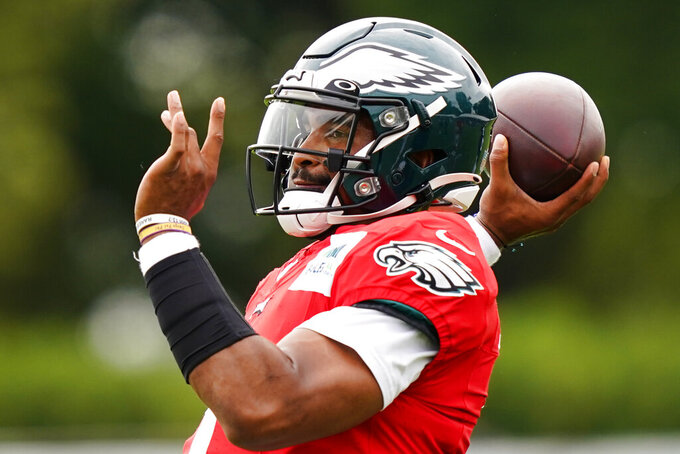 Philadelphia Eagles quarterback Jalen Hurts throws a pass during a joint practice with the New England Patriots at the Eagles NFL football training camp Monday, Aug. 16, 2021, in Philadelphia. (AP Photo/Matt Rourke)