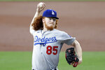 Los Angeles Dodgers starting pitcher Dustin May works against a San Diego Padres batter during the first inning of a baseball game Tuesday, Aug. 4, 2020, in San Diego. (AP Photo/Gregory Bull)