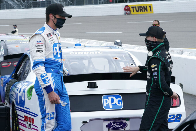 Austin Cindric, left, talks with fellow driver Justin Haley, right, prior to the start of a NASCAR Xfinity Series auto race Saturday, Sept. 1, 2020, in Richmond, Va. (AP Photo/Steve Helber)