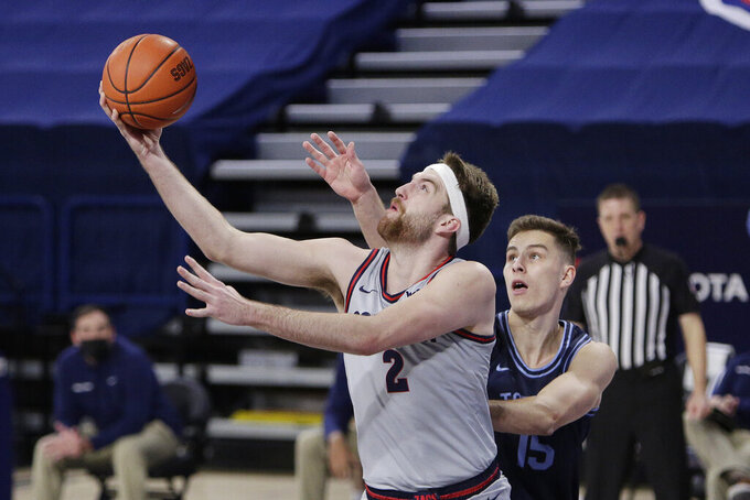 Gonzaga forward Drew Timme (2) shoots in front of San Diego center Vladimir Pinchuk (15) during the first half of an NCAA college basketball game in Spokane, Wash., Saturday, Feb. 20, 2021. (AP Photo/Young Kwak)