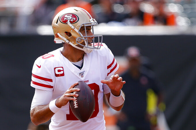 San Francisco 49ers quarterback Jimmy Garoppolo looks to pass during the first half an NFL football game against the Cincinnati Bengals, Sunday, Sept. 15, 2019, in Cincinnati. (AP Photo/Gary Landers)