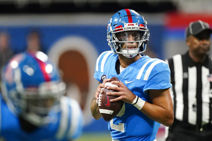 Mississippi quarterback Matt Corral (2) drops back to pass during the first half of an NCAA college football game against Louisville Monday, Sept. 6, 2021, in Atlanta. (AP Photo/John Bazemore)