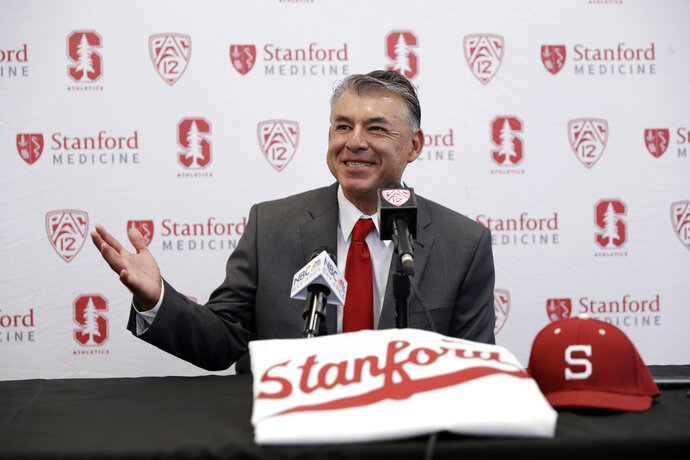 FILE - In this June 20, 2017, file photo, David Esquer fields questions during a press conference introducing him as the new head coach of the Stanford NCAA college baseball team in Stanford, Calif. Esquer didn't shy away from the tough task of following a coaching legend. Esquer instead leaped at the opportunity to take over for his mentor, Mark Marquess, as Stanford's baseball coach. Esquer begins his tenure for the Cardinal on Friday night, Feb. 16, 2018, when Stanford hosts Cal-State Fullerton at Sunken Diamond. (AP Photo/Marcio Jose Sanchez, File)