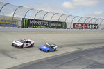 Denny Hamlin (11) leads Alex Bowman (88) during the NASCAR Cup Series auto race, Monday, May 6, 2019, at Dover International Speedway in Dover, Del. (AP Photo/Will Newton)