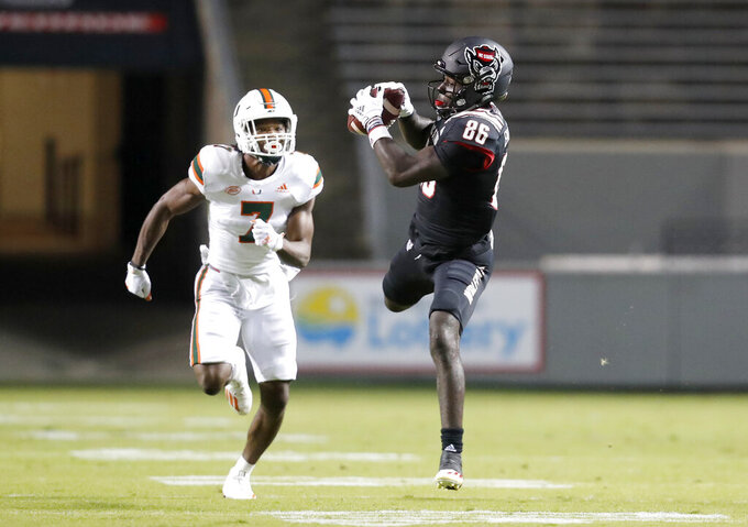 North Carolina State wide receiver Emeka Emezie (86) pulls in a reception in front of Miami cornerback Al Blades Jr. (7) during the first half of an NCAA college football game Friday, Nov. 6, 2020, in Raleigh, N.C. (Ethan Hyman/The News & Observer via AP, Pool)