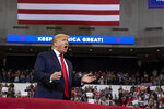 President Donald Trump arrives to speak at a campaign rally at the CenturyLink Center, Thursday, Nov. 14, 2019, in Bossier City, La. (AP Photo/ Evan Vucci)