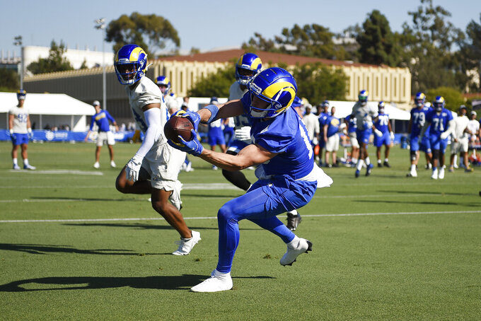 Los Angeles Rams wide receiver Cooper Kupp catches a pass for a touchdown in a red-zone drill during NFL football training camp practice in Irvine, Calif., Saturday, July 31, 2021. (AP Photo/Kelvin Kuo)