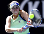 Sofia Kenin of the U.S. makes a backhand return to compatriot Coco Gauff during their fourth round singles match at the Australian Open tennis championship in Melbourne, Australia, Sunday, Jan. 26, 2020. (AP Photo/Andy Brownbill)