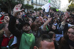 Algerian demonstrators take to the streets in the capital Algiers to reject the presidential elections, in Algeria, Thursday, Dec. 12, 2019. Five candidates have their eyes on becoming the next president of Algeria _ without a leader since April _ in Thursday's contentious election boycotted by a massive pro-democracy movement. (AP Photo/Fateh Guidoum)
