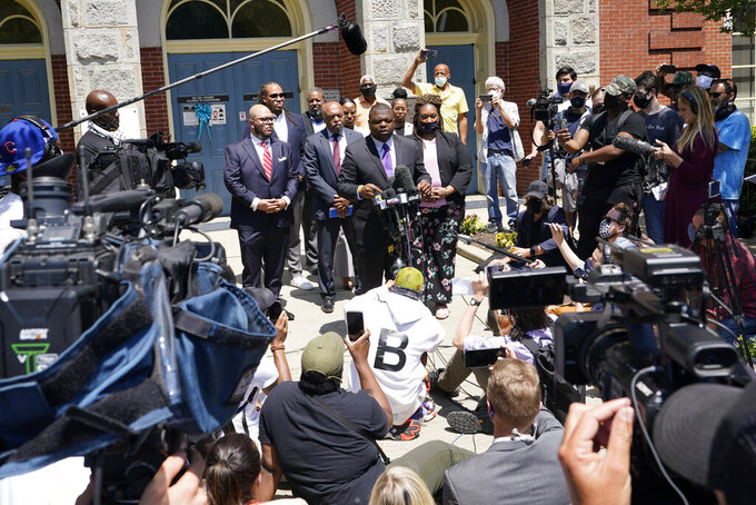 Attorneys for the family of Andrew Brown, Harry Daniel, at podium, makes comments after a judges decision on the release body cam video of the shooting of Andrew Brown Jr. in Elizabeth City, N.C., Wednesday, April 28, 2021. A judge denied the request to immediately release body cam video of the incident. (AP Photo/Steve Helber)