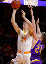 Tennessee forward Brock Jancek (34) attempts a shot against Tennessee Tech guard Garrett Golday (24) in the second half of an NCAA college basketball game Saturday, Dec. 29, 2018, in Knoxville, Tenn. Tennessee wins 96-53. (AP Photo/Shawn Millsaps)