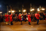 Flambeaux's cary their torches in the Krewe of Orpheus in New Orleans, Monday, Feb. 12, 2018. Tens of thousands of revelers are expected on New Orleans streets for parades and rowdy fun as Mardi Gras caps the Carnival season in a city with a celebration of its own, its 300th anniversary. (AP Photo/Gerald Herbert)
