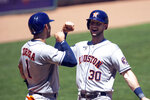 Houston Astros' Kyle Tucker (30) celebrates his two-run home run with teammate Carlos Correa (1) in the fourth inning of a baseball game against the Minnesota Twins, Sunday, June 13, 2021, in Minneapolis. (AP Photo/Andy Clayton-King)