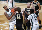 Michigan State's Nick Ward, left, and Gabe Brown (13) and Purdue's Ryan Cline (14) and Evan Boudreaux battle for the ball during the first half of an NCAA college basketball game, Tuesday, Jan. 8, 2019, in East Lansing, Mich. (AP Photo/Al Goldis)