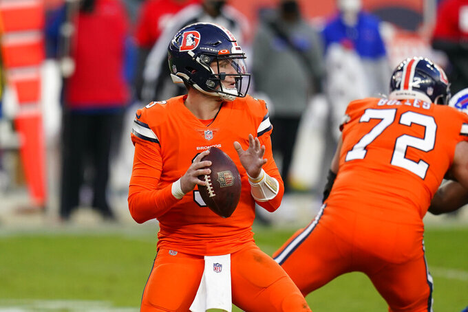 Denver Broncos quarterback Drew Lock throws a pass during the first half of an NFL football game against the Buffalo Bills, Saturday, Dec. 19, 2020, in Denver. (AP Photo/Jack Dempsey)