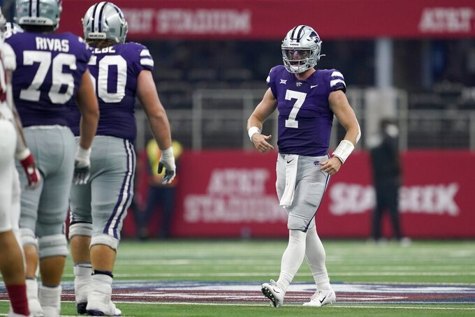 Kansas State offensive lineman Josh Rivas (76) and offensive lineman Cooper Beebe (50) celebrate with quarterback Skylar Thompson (7) after their NCAA college football game against Stanford in Arlington, Texas, Saturday, Sept. 4, 2021. (AP Photo/Tony Gutierrez)