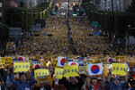 Supporters of South Korea's Justice Minister Cho Kuk shout slogans as they hold banners during a rally near Seoul Central District Prosecutors' Office in Seoul, South Korea, Saturday, Oct. 5, 2019. The letters read