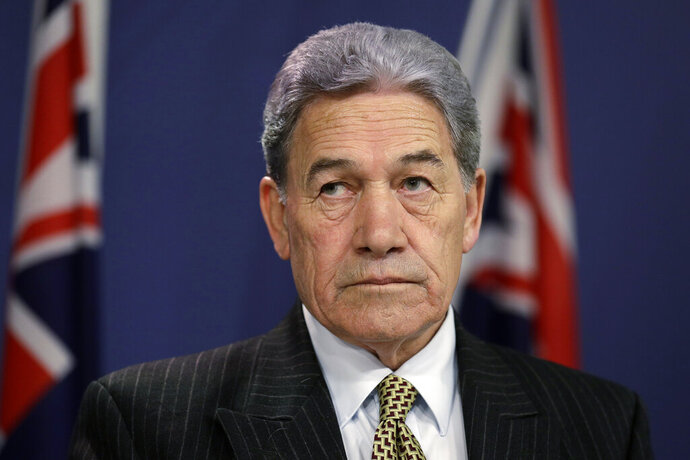 FILE - In this Oct. 4, 2019, file photo, New Zealand Foreign Minister Winston Peters listens during a press conference with Australian Foreign Minister Marise Payne following the Australia-New Zealand Foreign Minister Consultations in Sydney. ew Zealand announced Tuesday, July 28, 2002 it will follow the lead of its intelligence allies by suspending its extradition treaty with Hong Kong. The move comes in response to China passing a sweeping new security law for the semi-autonomous territory. Peters said the new law went against commitments China had made to the international community. (AP Photo/Rick Rycroft, File)