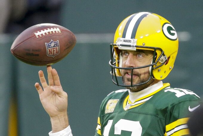 Green Bay Packers' Aaron Rodgers warms up before an NFL football game against the Jacksonville Jaguars Sunday, Nov. 15, 2020, in Green Bay, Wis. (AP Photo/Mike Roemer)