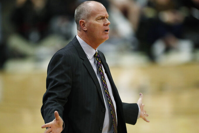 FILE - Colorado head coach Tad Boyle argues with referees for a call in the first half of an NCAA college basketball game in this Sunday, Jan. 12, 2020, file photo taken in Boulder, Colo. Boyle and his team are preparing for the upcoming PAC-12 season. (AP Photo/David Zalubowski, File)