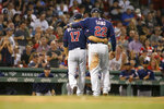 Minnesota Twins starting pitcher Jose Berrios (17) and third baseman Miguel Sano (22) leave the field at the end of the fifth inning of the team's baseball game against the Boston Red Sox on Wednesday, Sept. 4, 2019, in Boston. (AP Photo/Mary Schwalm)