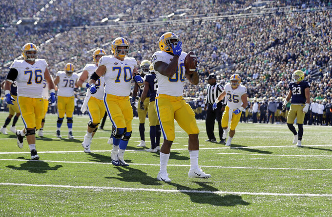 Pittsburgh running back Qadree Ollison (30) celebrates a touchdown run against Notre Dame during the first half of an NCAA college football game, Saturday, Oct. 13, 2018, in South Bend, Ind. (AP Photo/Darron Cummings)