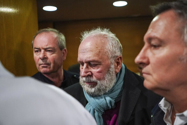 Former French priest Bernard Preynat, center, arrives at the Lyon court house, central France, Monday Jan.13, 2020. Bernard Preynat, is accused of sexually abusing some 75 Boy Scouts went on trial Monday _ but the proceedings were delayed until Tuesday because of a strike by lawyers. Preynat admitted in the 1990s to abusing boys, but was only removed from the priesthood last year. (AP Photo/Laurent Cipriani)