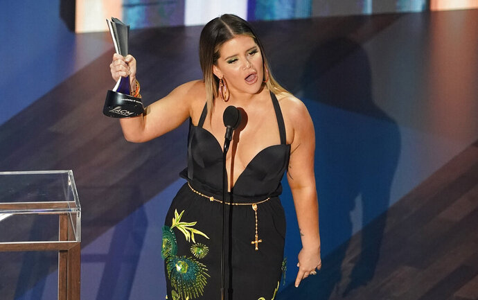Maren Morris accepts the female artist of the year award during the 55th annual Academy of Country Music Awards at the Grand Ole Opry House on Wednesday, Sept. 16, 2020, in Nashville, Tenn. (AP Photo/Mark Humphrey)