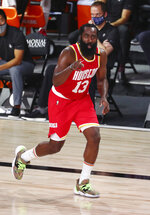 Houston Rockets guard James Harden (13) celebrates after making a three-point basket against the Indiana Pacers in the second half of an NBA basketball game Wednesday, Aug. 12, 2020, in Lake Buena Vista, Fla. (Kim Klement/Pool Photo via AP)