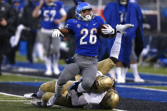 Buffalo running back Jaret Patterson (26) carries the ball during the first half of the team's NCAA college football game against Akron in Amherst, N.Y., Saturday Dec. 12, 2020. (AP Photo/Jeffrey T. Barnes)