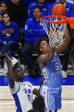 North Carolina's Armando Bacot (5) makes a basket in front of Pittsburgh's Eric Hamilton (0) during the first half of an NCAA college basketball game, Saturday, Jan. 18, 2020, in Pittsburgh. (AP Photo/Keith Srakocic)