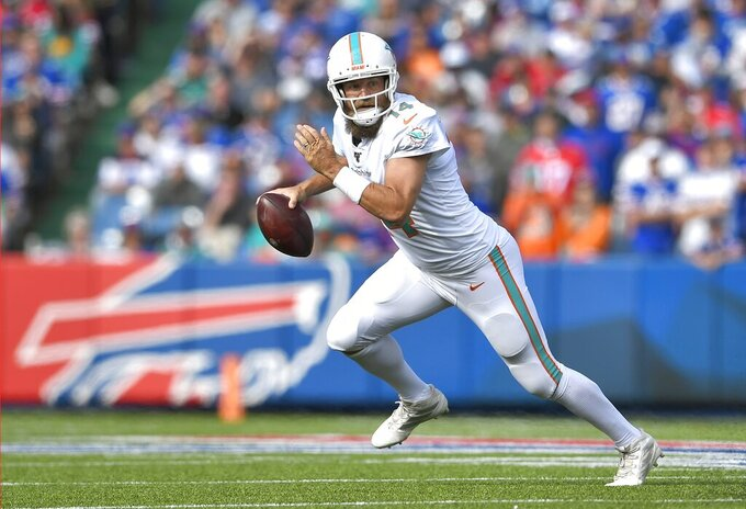 Miami Dolphins quarterback Ryan Fitzpatrick scrambles against the Buffalo Bills in the first half of an NFL football game, Sunday, Oct. 20, 2019, in Orchard Park, N.Y. (AP Photo/Adrian Kraus)