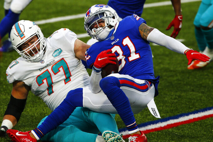 Buffalo Bills strong safety Dean Marlowe (31) is tackled on the run by Miami Dolphins defensive tackle Ray Smith (77) in the second half of an NFL football game, Sunday, Jan. 3, 2021, in Orchard Park, N.Y. (AP Photo/John Munson)