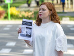 In this Saturday, June 22, 2019 photo, Ashley Fine stops motorists in Liberty Park in Salt Lake City, as she hands out flyers with Mackenzie Lueck's photo on it. Police and friends are investigating the disappearance of the 23-year-old University of Utah student, whose last communication with her family said she arrived at Salt Lake City International Airport on Monday, June 17. (Rick Egan/The Salt Lake Tribune via AP)