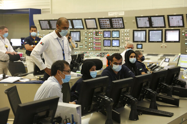 In this undated photograph published by the United Arab Emirates' state-run WAM news agency, employees work at the Barakah Nuclear Power Plant in the UAE's far western desert. The Barakah Nuclear Power Plant in the oil-rich United Arab Emirates has been connected to the country's power grid, authorities said Wednesday, Aug. 19, 2020. (WAM via AP)