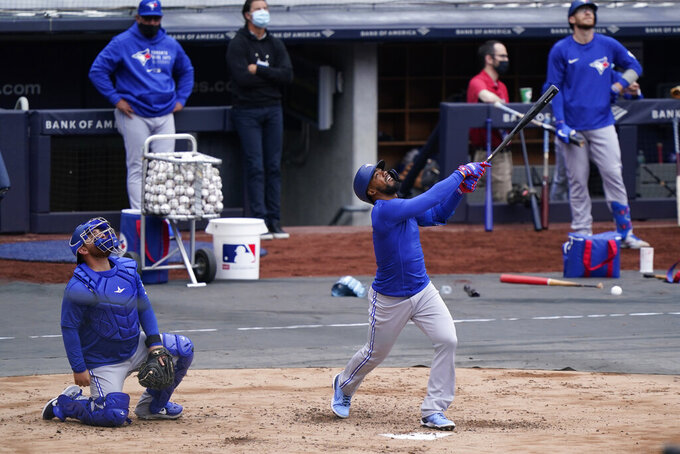 Toronto Blue Jays Teoscar Hernandez reacts as he pops up during batting practice in a workout, Wednesday, March 31, 2021, at Yankee Stadium in New York. The Blue Jays face the New York Yankees on opening day Thursday in New York. (AP Photo/Kathy Willens)