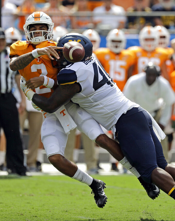 Tennessee-West Virginia game resumes after weather delay