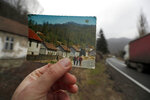 In this photo taken on Thursday, Jan. 23, 2020, an old postcard shows how the village of Blagojev Kamen, Serbia looked like fifty years ago. Near-empty villages with abandoned, crumbling houses can be seen all over Serbia — a clear symptom of a shrinking population that is raising acute questions over the economic well-being of the country. The decline is happening so fast it's considered a national emergency and the United Nations has stepped in to help. (AP Photo/Darko Vojinovic)