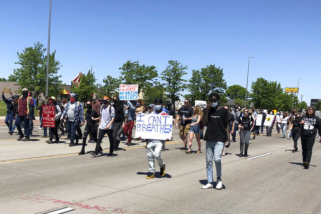 Hundreds of people march on the streets of Fargo, N.D., Saturday, May 30, 2020, to protest the death of George Floyd, a black man who was killed in police custody in Minneapolis on May 25.  (AP Photo/Dave Kolpack)