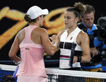 Australia's Ashleigh Barty, left, is congratulated by Greece's Maria Sakkari after winning their third round match at the Australian Open tennis championships in Melbourne, Australia, Friday, Jan. 18, 2019. (AP Photo/Kin Cheung)