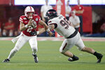 Nebraska quarterback Adrian Martinez (2) runs past a tackle-attempt by Northern Illinois defensive tackle Jack Heflin (98) during the first half of an NCAA college football game in Lincoln, Neb., Saturday, Sept. 14, 2019. (AP Photo/Nati Harnik)