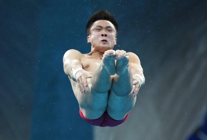 Cao Yuan of China competes in men's diving 10m platform final at the Tokyo Aquatics Centre at the 2020 Summer Olympics, Saturday, Aug. 7, 2021, in Tokyo, Japan. (AP Photo/Dmitri Lovetsky)