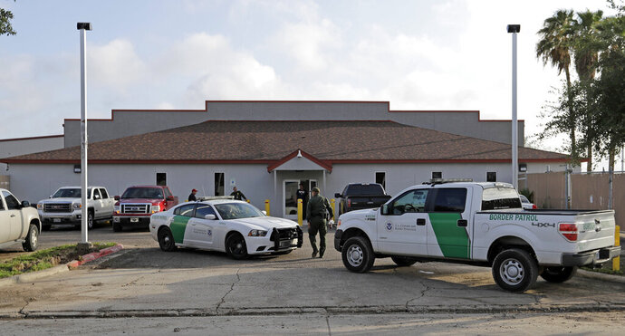 FILE - In this Saturday, June 23, 2018, file photo, a U.S. Border Patrol Agent walks between vehicles outside the Central Processing Center in McAllen, Texas. Advocates were shocked to find an underage mom and her tiny, premature newborn daughter huddled in a Border Patrol facility the second week of June 2019, in what they say was another example of the poor treatment immigrant families receive after crossing the border. The mother is a Guatemalan teen who crossed the border without a parent and was held at a facility in McAllen, Texas, with other families with children. (AP Photo/David J. Phillip, File)