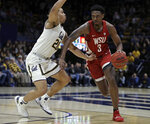 Washington State's Robert Franks, right, drives the ball against California's Matt Bradley (20) in the first half of an NCAA college basketball game Saturday, March 2, 2019, in Berkeley, Calif. (AP Photo/Ben Margot)