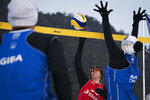 Austria's Stefanie Schwaiger, center, scores past China's Xue Chen during a snow volleyball exhibition match at the Austria House in Pyeongchang, South Korea, Wednesday, Feb. 14, 2018. Europe has a small snow volleyball league, and promoters showed off the sport in an exhibition match before hundreds of curiosity seekers. (AP Photo/Felipe Dana)