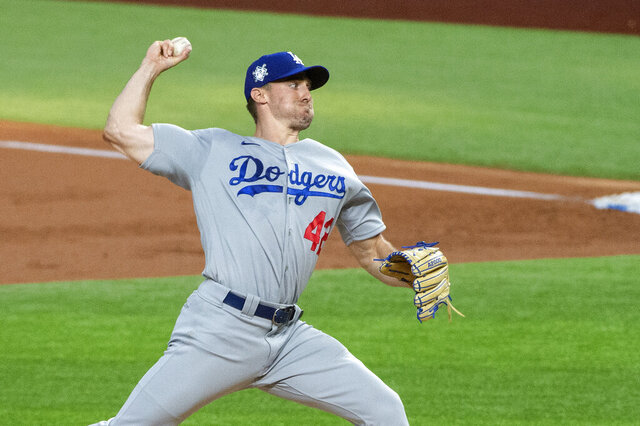 Los Angeles Dodgers starting pitcher Ross Stripling works against the Texas Rangers during the first inning of a baseball game Saturday, Aug. 29, 2020, in Arlington, Texas. (AP Photo/Jeffrey McWhorter)