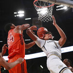Georgia Tech forward James Banks III is fouled while battling for a rebound with Virginia Tech forward Kerry Blackshear Jr. during the first half of an NCAA college basketball game Wednesday, Jan. 9, 2019, in Atlanta. (Curtis Compton/Atlanta Journal-Constitution via AP)