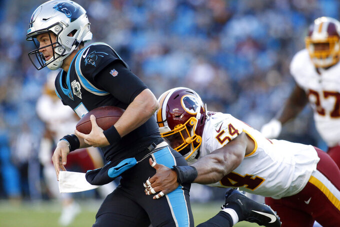 Carolina Panthers quarterback Kyle Allen (7) runs while Washington Redskins linebacker Myles Humphrey (54) tackles during the second half of an NFL football game in Charlotte, N.C., Sunday, Dec. 1, 2019. (AP Photo/Brian Blanco)