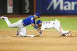 Chicago Cubs' second baseman Addison Russell, left, tags out New York Mets' Michael Conforto, right, out at second after catching Conforto stealing during the sixth inning of a baseball game Thursday, Aug. 29, 2019, in New York. (AP Photo/Kathy Willens)